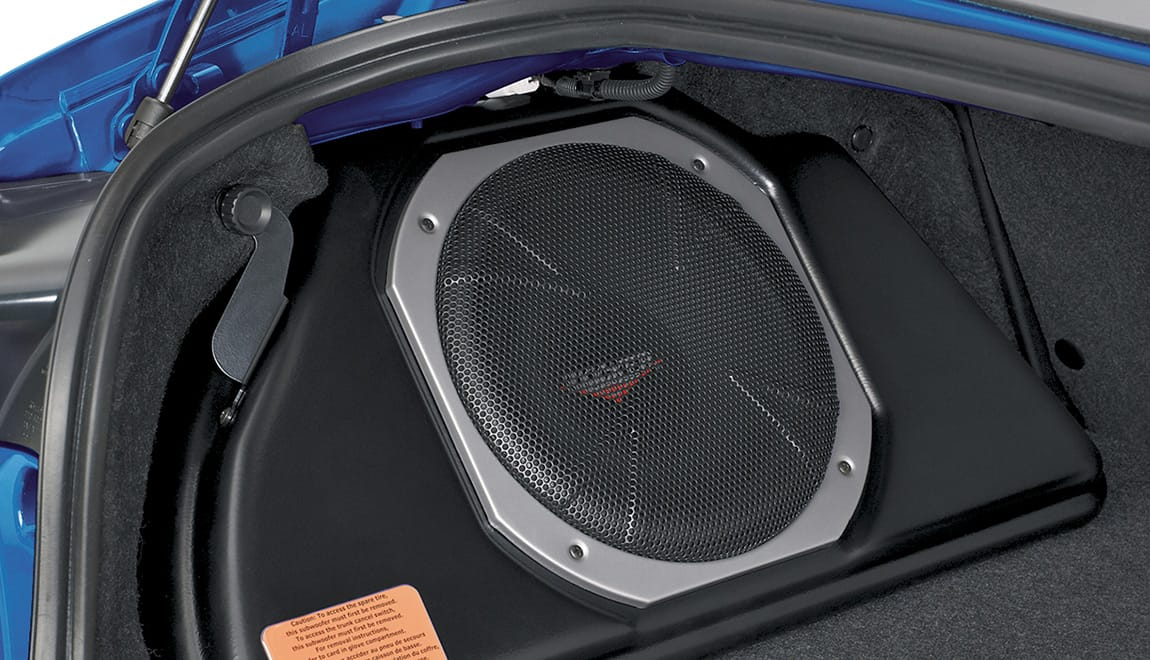 Provides powerful, deep bass and also assists in clean sound reproduction from all vehicle speakers. This is achieved by its integrated 100W amplifier and a passive crossover network. The self-contained unit mounts in the trunk. Manufactured for Subaru of America by Kicker.<sup>®</sup> Cannot be installed with Cargo Tray.