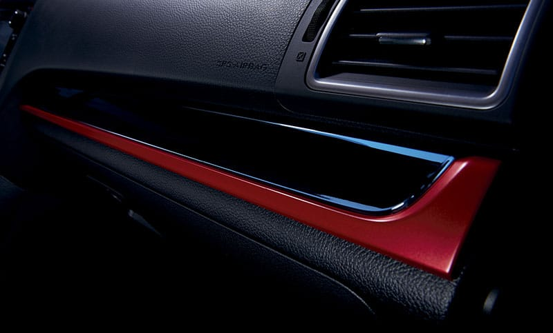 <b>Red and Gloss Black Trim</b>  Distinctive red and gloss black trim runs across the dash to complete its bold look.<br><br>
