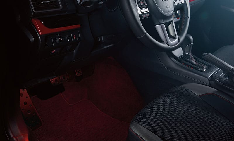 <b>Interior Illumination System</b>  A flood of warm red light casts its glow on the cabin floor as you enter the Crosstrek Special Edition.<br>