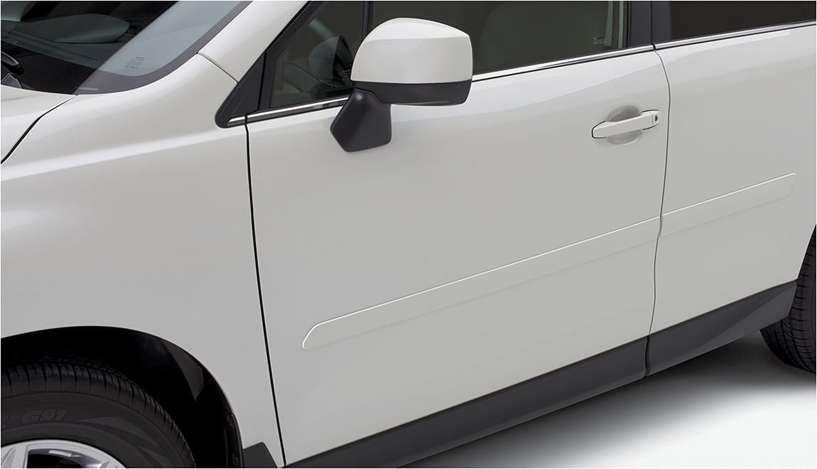 Color-matched moldings help protect vehicle doors from parking lot dings while attractively blending with the lines of the car.
