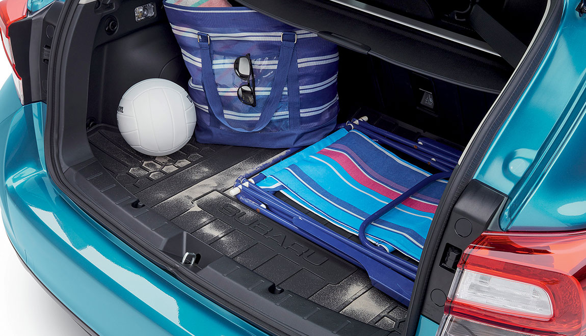 Removable tray helps to protect the cargo area from stains, dirt and other messes while providing a surface that helps reduce the shifting of cargo while driving.