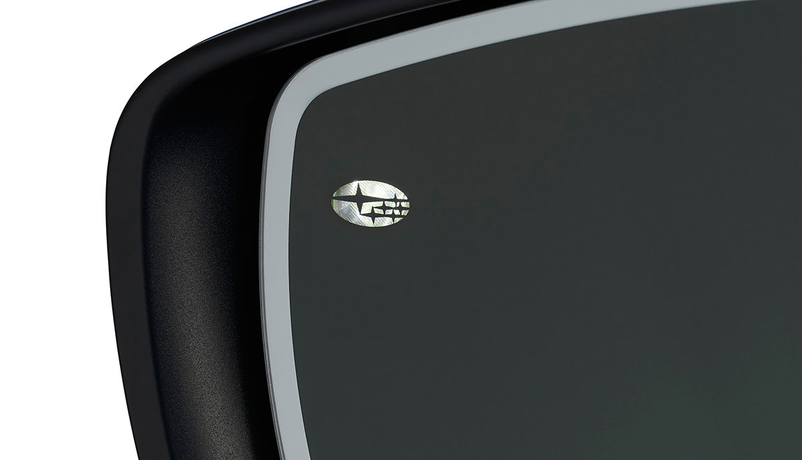 Enhance your Auto-Dimming Mirror experience by adding the Exterior Auto-Dimming Mirrors with Approach Light.* Open or unlock the doors with the keyless entry system and LED lights located behind the Subaru logo in each exterior mirror help to light the way. Light is cast down all four doors and onto the ground next to and towards the rear of the vehicle. When in traffic, the Exterior Auto-Dimming Mirrors help add to a safer driving experience by reducing headlight glare on the exterior mirrors. This occurs when excessive light is detected from the rear of the vehicle. The dimming level of the exterior mirrors is regulated by the level of light detected by the Interior Auto-Dimming Mirror.
