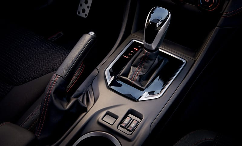 The leather-trimmed gear shift features exclusive red stitching and a gloss black surround.