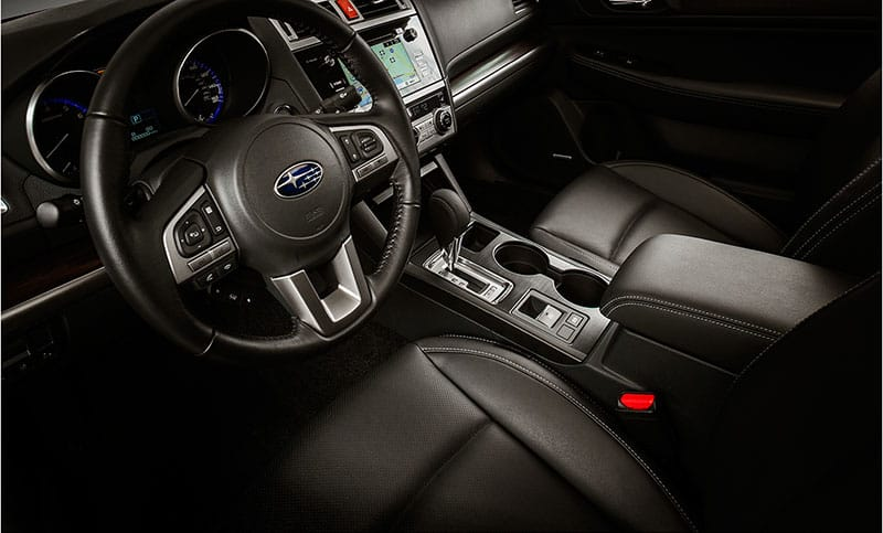 <b>Leather-trimmed Interior </b><br><br>Settle into plush comfort with perforated, leather-trimmed front and rear seats.<br>