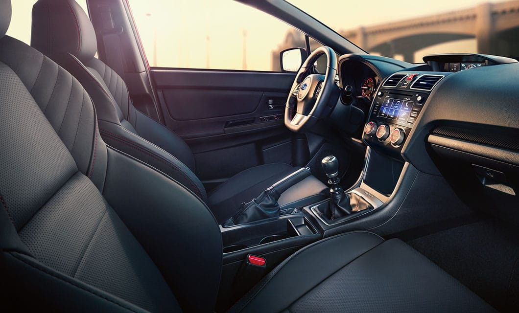 <br>The WRX cockpit is driver-focused, but also passenger-focused with comfortable, supportive seating and standard SUBARU STARLINK™ in-vehicle technology.<br><br><br>