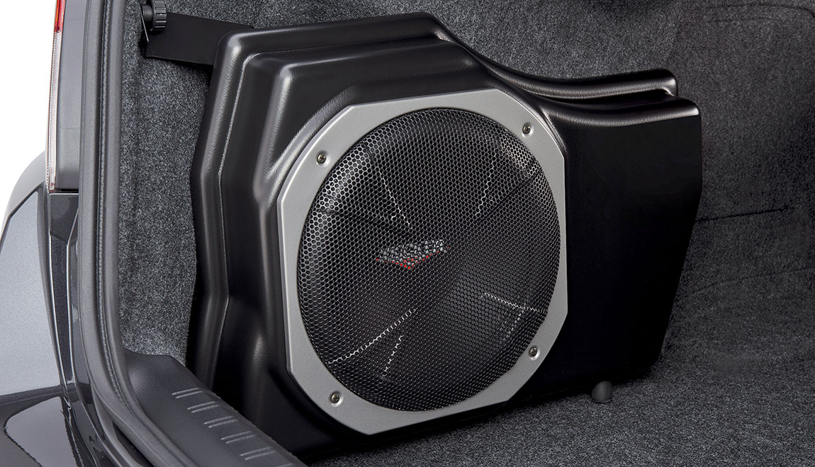 Provides powerful deep bass, and assists in clean sound reproduction from all vehicle speakers. This is achieved by its integrated 100W amplifier and a passive crossover network. The self-contained unit mounts in the trunk.