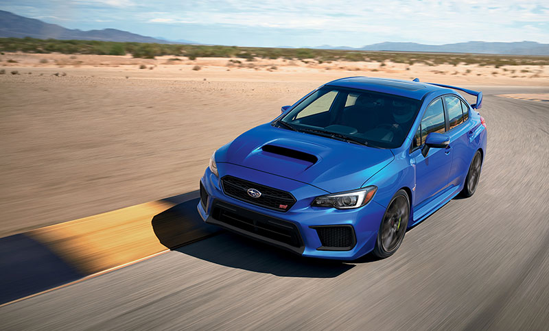 <br>The WRX STI has a 4-wheel independent suspension with aluminum front lower control arms, and a double wishbone rear suspension—tuned and tweaked by Subaru Tecnica International. Body roll is almost non-existent, thanks to pillow-ball joint mounts and bushings throughout, optimized spring-rates, and just the right amount of sway bar stiffness. Working in unison with an ultra stiff unibody chassis, the WRX STI corners with precision and holds lines better than any sedan has the right to.