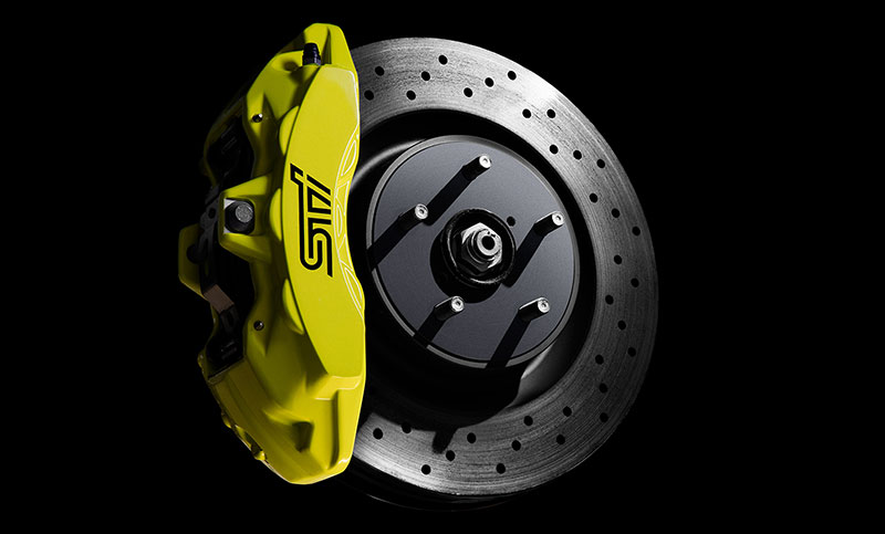 <br>There's a reason why the name Brembo<sup>®</sup> demands such respect. Case in point, the braking system of the WRX STI. With powerful, cross-drilled/ventilated 13.4-inch front and 12.8-inch rear rotors coupled with massive 6-piston front and dual-piston rear monoblock calipers, and aided by the technological wizardry of Super Sport ABS with Electronic Brake-force Distribution (EBD), this setup more than lives up to the Brembo<sup>®</sup> pedigree. They offer powerful, progressive, and predictable braking feel from the first lap to the last<sup>1</sup>.