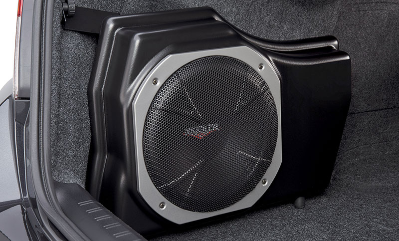 <b>Kicker<sup>&reg;</sup> Powered Subwoofer</b><br><br>Provides powerful deep bass, and assists in clean sound reproduction from all vehicle speakers. This is achieved by its integrated 100W amplifier and a passive crossover network. The self-contained unit mounts in the trunk.<b>Excludes models equipped with Harman Kardon<sup>&reg;</sup> audio.