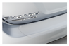 <b>Rear Bumper Appliqué</b><br><br>Clear, scratch-resistant vinyl film helps protect your bumper's upper surface and leading edge. Includes a discrete pearl-colored Subaru logo.